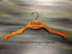 Bride to Be Hanger Bridal Hanger Bride by OriginalBridalHanger  $29.99  Click on photo to BUY NOW!  Are you a bride looking for a unique bride hanger to display your dress on? This cherry stained wedding hanger is strong and handmade. #originalbridalhanger sells a variety of hangers.  Click here: originalbridalhanger.etsy.com to see your options.