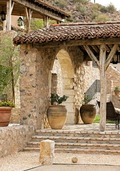 Rustic Tuscan style.  Natural, warm, inviting.
