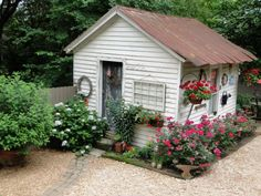 I like the vintage hanging window in the front.  Great idea for the sides of the garden shed!