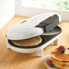 """One versatile 4-in-1 maker does it all: pancakes, omelettes, crepes and quesadillas. Flawless food release means you'll have the perfect meal each and every time!   non-stick coated baking plate thermostatically-controlled lamp cool-touch housing and handle plastic/aluminum ETL listed 1200 watts dimensions: 3¾"""" x 11½"""" x 7¾"""" preparing breakfast is a breeze with our toasters, waffle makers & griddles. Shop now!   Why Buy? Our kitchen electrics do more than your ..."""