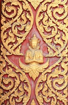 Traditional thai style art carving at the door of temple