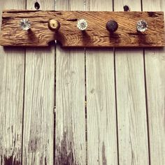 idea for coat rack in the kitchen (buy door knobs from Hobby Lobby and find wood and stain)