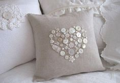 SEWING PILLOWS I dug through my shell shaped buttons and made this sweet pillow. The trick is to trace a heart with a water soluable marker, glue the buttons in place, and then sew them on. Sewing Pillows, Diy Pillows, Decorative Pillows, Throw Pillows, Button Art, Button Crafts, Heart Button, Sewing Crafts, Sewing Projects