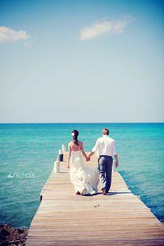 Wedding Couple on the West Bay Dock on Grand Cayman - #destination wedding