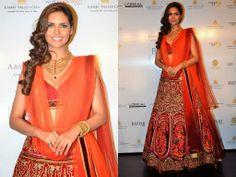 Bollywood actress Esha Gupta in beautiful red designer bridal lehenga. Designed by JJ Valaya at Aamby Valley India Bridal Week 2013