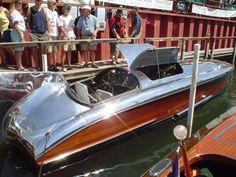 """""""Hornet II"""" , 1930/1939 29'6″ Gar Wood Step-hull Hydroplane. One of ten built by Gar Wood between 1929 and 1934 originally owned by Henry J. Kaiser who, after losing the Lake Championship race to Mercury, an all aluminum boat, sent """"Hornet"""" to Howard Hughes who removed the wooden top and designed and built a custom aluminum top. """"Hornet"""" never lost another race and when it was retired in 1953 it had won more races than any other boat in such a short time frame. It is powered by a Packard…"""