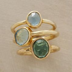 Stones that reflect the colors of the Aegean float amid rippled bands of 22kt vermeil. Handcrafted with blue and green quartz, London blue topaz. Size, shape and color of stones will vary. Set of 3. Whole sizes 5 to 9.
