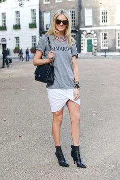 This Is It — A Look Back at the Year's Best Street Style : A quirky t-shirt got a dramatic skirt complement thanks to her white wrap iteration on bottom.