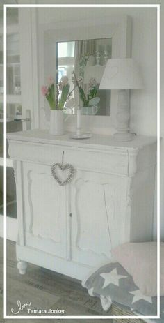 Lovely white cabinet & mirror by Tamara Jonker # stars # grey # cozy # home inspirations # landelijke stijl # candle # beautiful