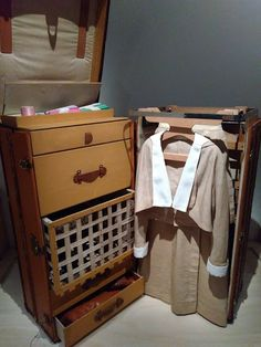 """""""Complete Wardrobe Trunk in Vuittonite Canvas,"""" ca. 1914, coated canvas, wood, brass, leather, metal, textile, Louis Vuitton Collection from Volez Voguez Voyager Exhibit Louis Vuitton Collection, Exhibit, Trunks, Textiles, Brass, Canvas, Metal, Wood, Leather"""