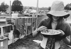 A girl helps herself to a free food ration in the camp area at the Woodstock Music Festival in Bethel, N. on Aug. (AP Photo) - interesting story about the food of Woodstock at the link