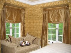Pleated Draperies on Decorative Hardware over Relaxed Roman Shades