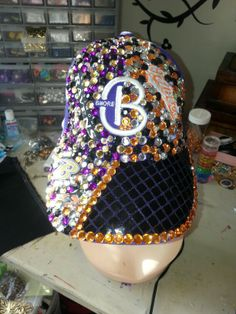 Baltimore orioles and ravens hand made hat. Available at Atouchofclassjewelry85.com