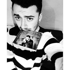"""""""Just received The Drowning Shadows edition of my album in PHYSICAL form. Nothing beats this feeling. Physically holding something I've created. Eurgh. I love music ❤️❤️""""- Sam Smith"""