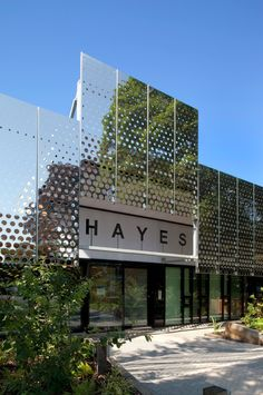 The expansion of Hayes Primary School in Croydon has transformed the whole structure of the school and its learning environments. The expansion has enabled the number of pupils to be increased from 315 to 420. A new aluminium screen was constructed to the front and side elevations. The screen's purpose is to reflect the canopies of the mature trees surrounding the site and, in turn, reduce the apparent visual mass of the building.