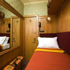 I triple love the train compartment vibe here. what a cute idea for an adorable (tiny) guest room.