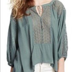 Free People Moon River Blouse Oversized shapeless floral jacquard blouse with a hi-lo hem and bubble three quarter sleeves. Daisy lace yoke and inserts on sleeves. 100% Rayon * Machine wash cold Free People Tops Blouses