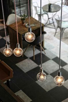 Do you have tall ceilings? Adding some unique, low-hanging light fixtures can create a more intimate vibe in the space. And the industrial-style lighting trend isn't going anywhere any time soon! Decor, Industrial Style Lighting, Interior, Industrial Style, Light Bulbs, House Styles, Lights, Cafe Design, Light