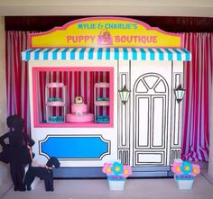 Puppy Themed Birthday Party. Gorgeous puppy boutique #desserttablescape store front, life size puppy houses for the relay races and puppy house centerpieces all custom made by #bambinisoiree.