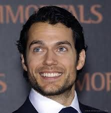 This is a goofy smile; I like it because it makes him look more real as opposed to model perfect.  :-)