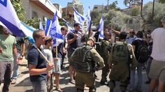 "Hebron's settlers singing ""Revenge"" and ""Damn them"" in front of police a..."