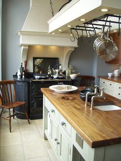 Beautiful bespoke kitchen design by Chalon with a decorative surround for the cooker hood Aga Cooker, Kitchen Cooker, Cooker Hoods, Aga Kitchen, Country Kitchen, Kitchen Dining, Kitchen Decor, Kitchen Ideas, Cottage Kitchens