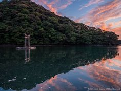Watazumi Shrine - Perhaps there is a god to protect the sea here. The torii a little red in a very mysterious sky. When the tide is full, beautiful scenery appears in the lower half.
