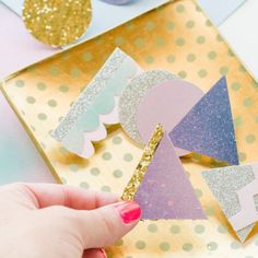 DIY Paper Brooches The perfect accessory to a sweater, bracelet, top knot, or backpack! These simple paper brooches are colorful and kind of awesome.