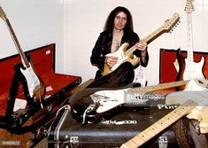 Photo of DEEP PURPLE and Ritchie BLACKMORE Ritchie Blackmore posed backstage with collection of Fender Stratocaster guitars