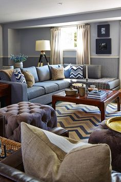 Color!  I love the mix and play going on here. Casual relaxed inviting, but fun!  Definitely think this is in the mix for media/rec room.  Hate the couch though -- want more relaxed arms. Love the ottomans though.    sarah richardson design real potential basement