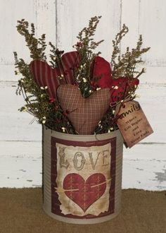 I have added a grungy ivory finish to this tin and then filled it with three of my handmadeprimitive hearts, dried floral and berries. I have added a nice primitive Valentine Love graphic to the front of the tin. Will make a nice shelf sitter décor for your Valentine and everyday home décor. I have added a grungy tag to the side of the arrangement with the saying FAMILY WhereLife Begins and Love Never Ends.   Measures approx 10 x 15-16      Ready to ship in 2-3 days #handmadehomedecor