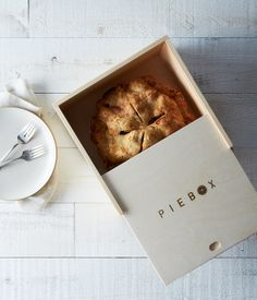 """""""Many cooks focus on getting the pie crust just right, but then forget they have to get the fragile pie to the party or picnic in one piece. This handsome pie box does the trick, in style."""" Pie Box at Provisions, $35.    Photo by James Ransom."""