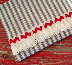 vintage ticking zippered pouch with rick rack and eyelet via thehemline