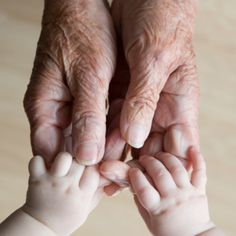 I love the juxtaposition of elderly hands with baby hands. <3