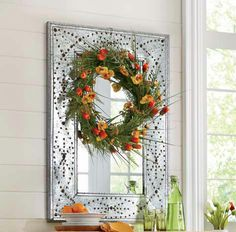 While filling up vases with fresh-cut stems from your garden is a great way to invite the outdoors inside, think about adding flowers in other ways too. Hang a wreath of wildflowers on a mirror, or place individual stems at table place settings. http://www.countrydoor.com