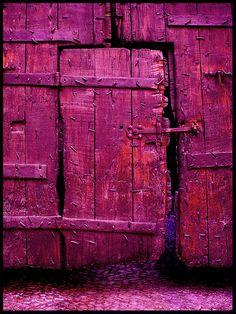 Bloody red purple door in Avignon, France