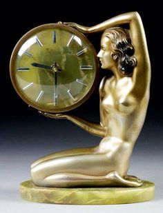 Art Deco bronze figure holding an onyx clock by Josef Lorenzl, Austria, ca.1930. ~via 20th Century Decorative Arts, FB
