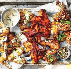 """Cherrywood smoked and livefire grilled buffalo chicken wings! Garlic & parmesan. Ghost pepper barbecue. Thai Chili and Honey-Glazed.  Prepared to tender glorious perfection and served alongside two handfuls of ice cold brewski. Cheers to beers! -David  PSA: Are you a BBQ Junkie? Love grilling like you love life? Click """"FOLLOW"""" for a guilt & gluten-free diet of daily food & travel pornography. Share via @regrann or @repost app.  Blog: http://ift.tt/1vCV6pv  #backyardbbqhero #grill #grilling…"""