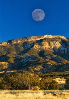 ♥New-Mexico-The moon rising over the Sandia Mts. in New Mexico… then it will set beyond the Rio Grande to the west.