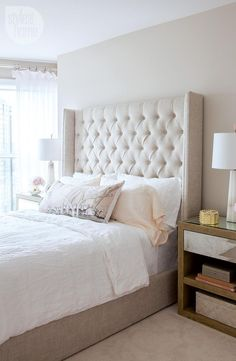 Beautiful bedroom features a beige tufted wingback bed dressed in white linen bedding flanked by wood and mirrored nightstands topped with Alabaster Quatrefoil Lamps. Dream Bedroom, Home Bedroom, Bedroom Decor, Bedroom Ideas, Blush Bedroom, Pretty Bedroom, Master Bedrooms, Master Suite, Wingback Bed