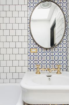 Patterned tile and white subway tile in the bathroom.