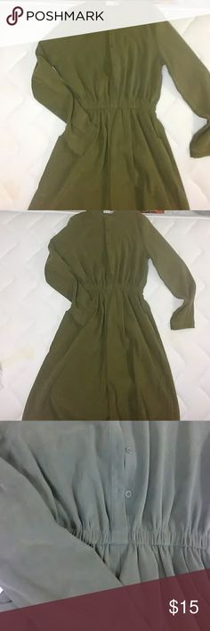 """Khaki/green dress Really cute dress, just not my color. Worn only a few times. Fits like S/XS. The material has a suede touch and look to it. Buttons in the front, on the cuffs, elastic waist. Right at the knee for 5'3"""". Dresses Midi"""