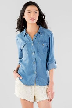 """The Brooks Chambray Blouse is a timeless staple for any season. A dark wash chambray makes up this button down blouse finished with pockets & tab sleeves. This blouse is perfect for layering under sweaters with a pair of leggings & boots.<br /> <br /> - 27"""" length from shoulder to hem<br /> - 36"""" chest<br /> - 41"""" waist<br /> - measured from a size small<br /> <br /> - 100% Lyocell<br /> - Dry Clean Only<br /> - Imported"""