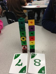 "Having the kids build towers when playing the ""war"" card game helps differentiate the game"