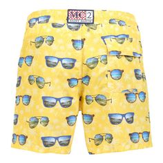 GUSTAVIA SWIM SHORTS WITH SUNGLASSES PRINT Yellow GUSTAVIA long Swim Shorts with tone on tone palm and jeep print and contrast all-over sunglasses print. Two side pockets. Back Velcro flap pocket. MC2 label on waist to the reverse. Elastic waistband with adjustable drawstring. Internal net. COMPOSITION: 100% NYLON. Model wears size M he is 189 cm tall and weighs 86 Kg.
