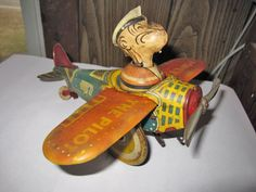 Popeye tin wind up plane..  I really like the faded colors on the old tin lithograph toys.