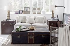 Coastal/Country decor, trunks as tables, linen and cream...