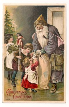 St Nicholas giving children gifts on a vintage card