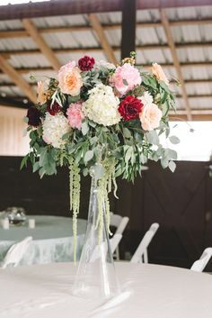 elevated centerpiece - photo by Sterling Imageworks http://ruffledblog.com/rainy-wedding-day-turned-day-after-session
