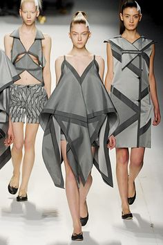 Issey Miyake fall 11 - origami, I like this because she uses triangles to create a big shape, I like that the colours are black and grey because they look shiny, the colour would also stand out on any skin clout which I like because it will suit anyone, I like that in most of her work she's stuck to the same triangle subject